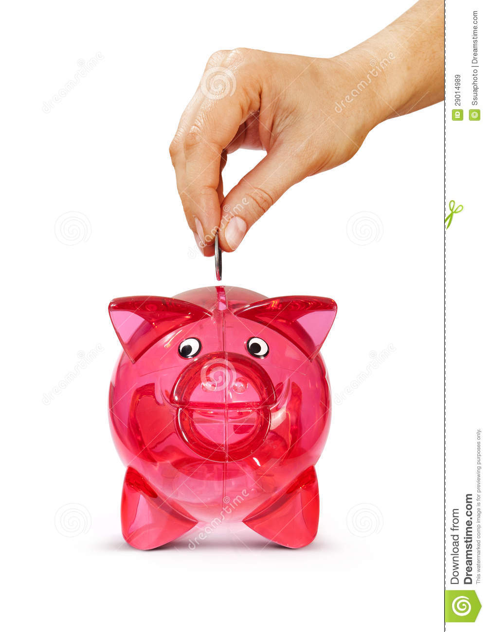 hand putting coin into piggy bank stock image