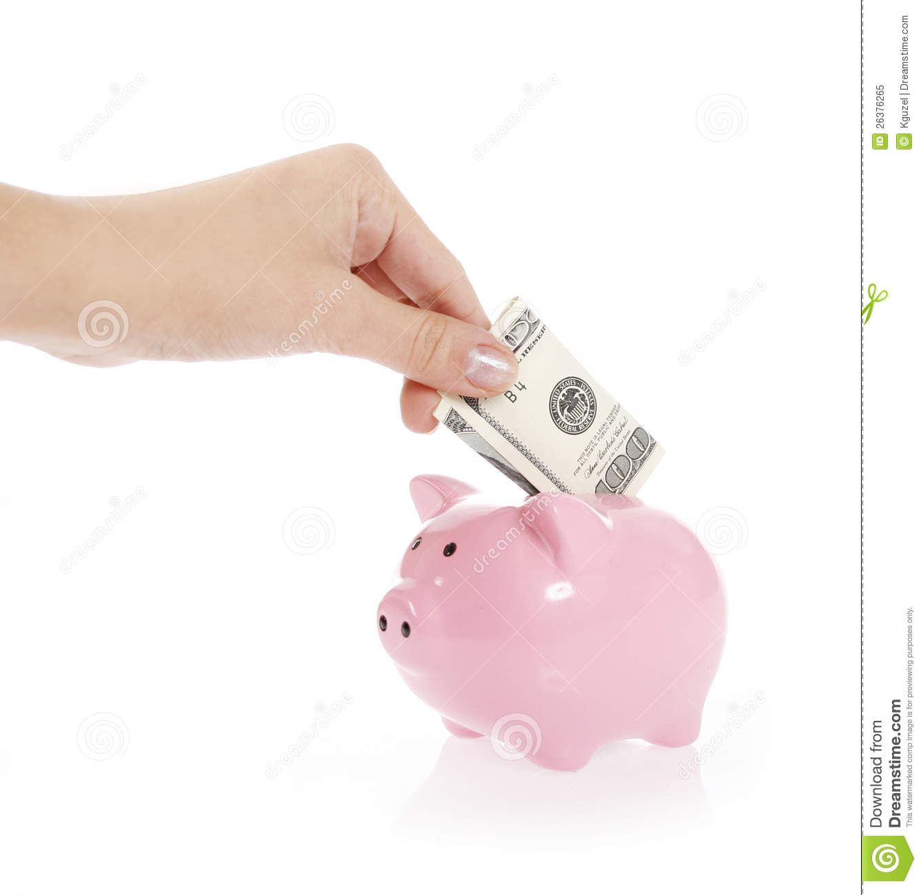 hand is putting money into piggy bank on white royalty