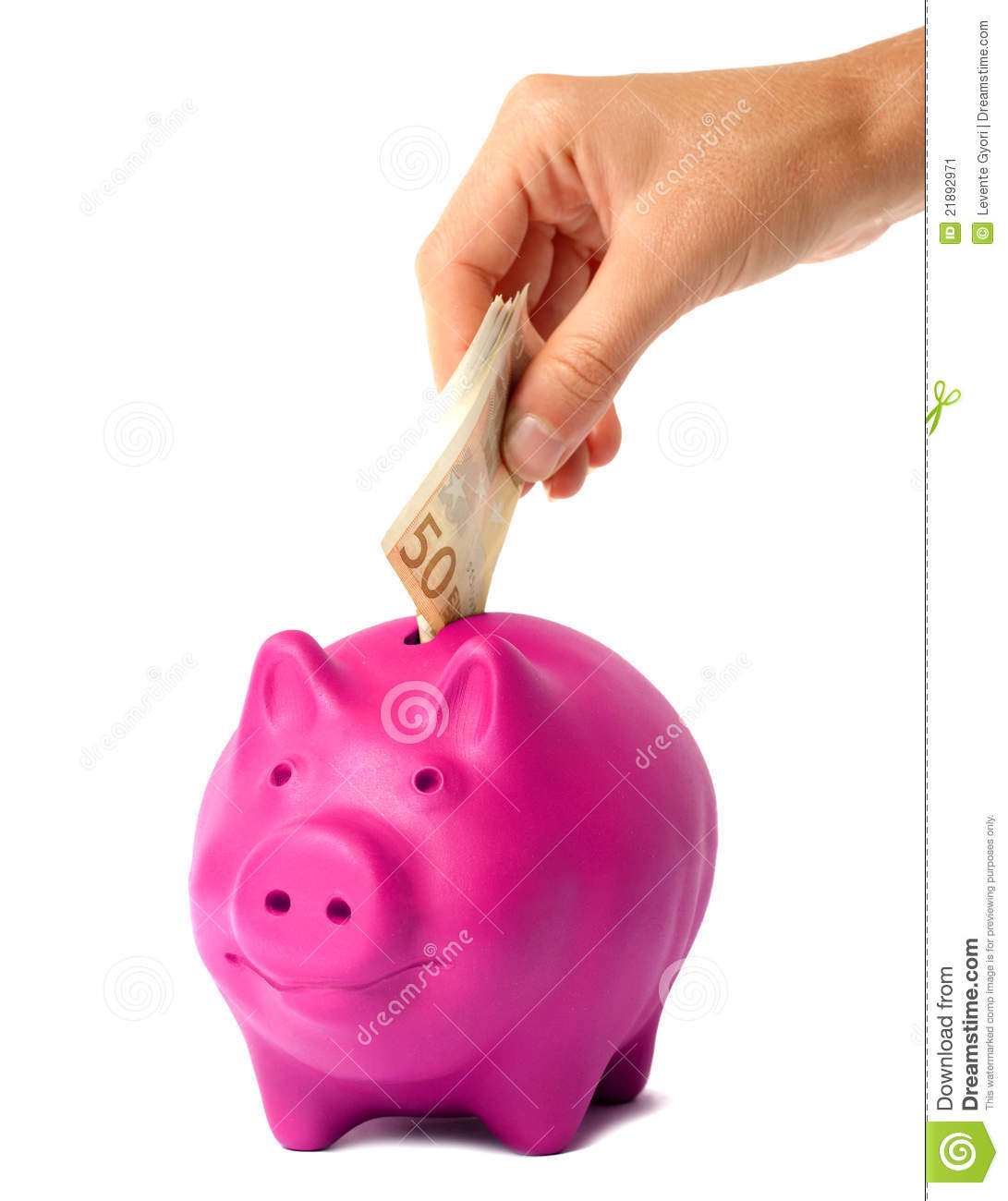 hand putting money into the pink piggy bank stock image