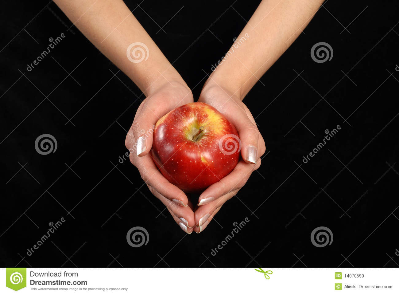hand with red apple fruit on black background stock photo
