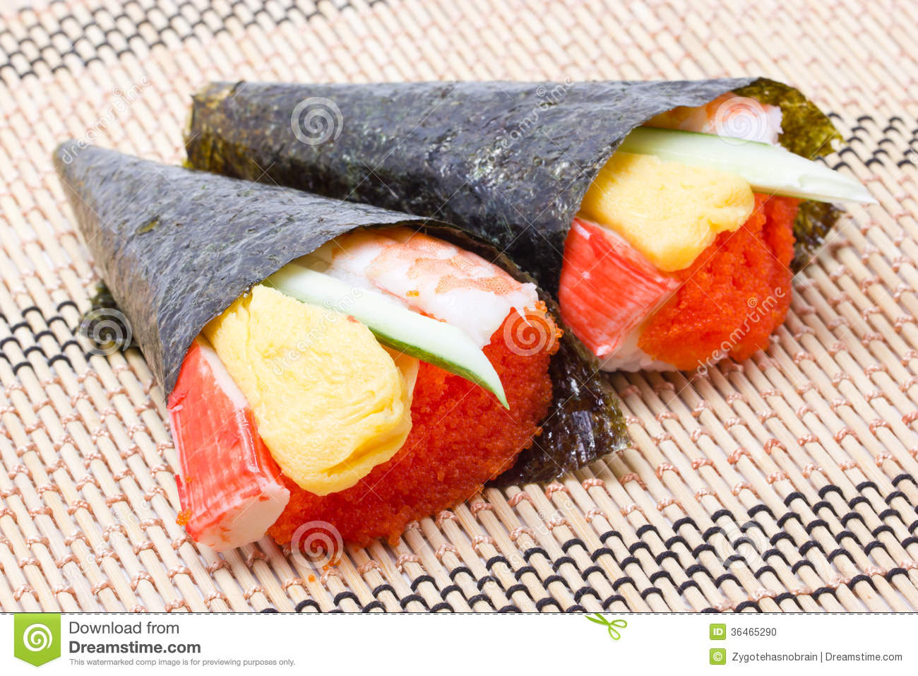 Hand rolled temaki sushi traditional japanese cuisine for Cuisine wooden