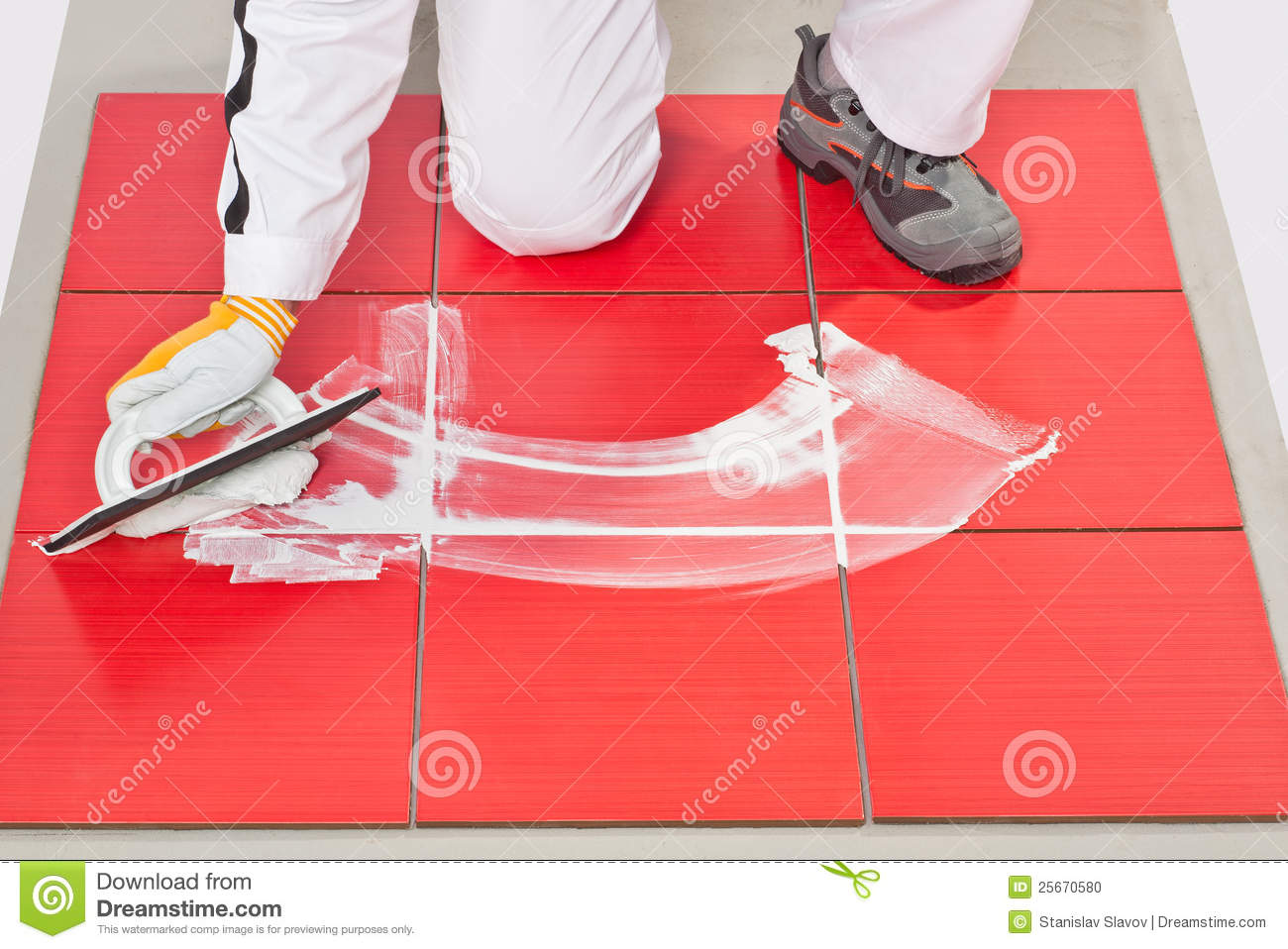Bathroom Tile Trowel : Hand with rubber trowel applying grout tile stock photo