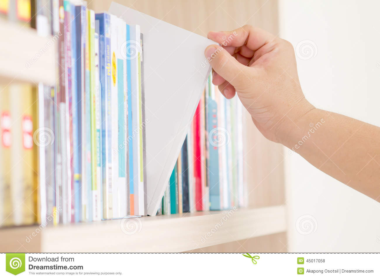 Hand Selecting Book From Bookshelf Download Preview