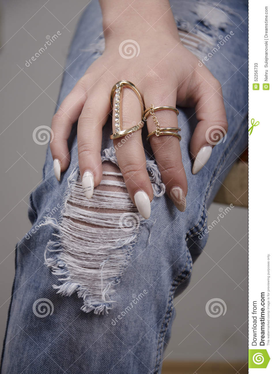 Hand Of A Girl With Gold Rings Stock Image - Image of gems, golden ...