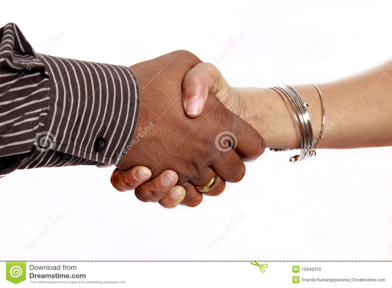 Handshake male and female meeting welcoming showing compassion. Business Meeting Handshake