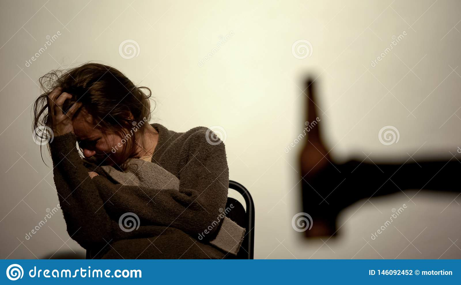 Hand showing bottle with beer alcohol addicted woman, rehabilitation, willpower