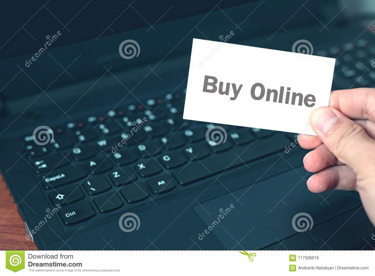 Hand Showing Business Card With A Buy Online Word Stock Image
