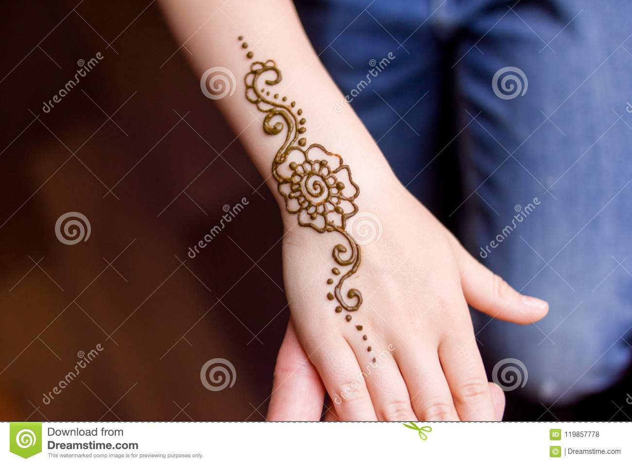Hand Of Small Girl Being Decorated With Henna Mehendi Tattoo Close