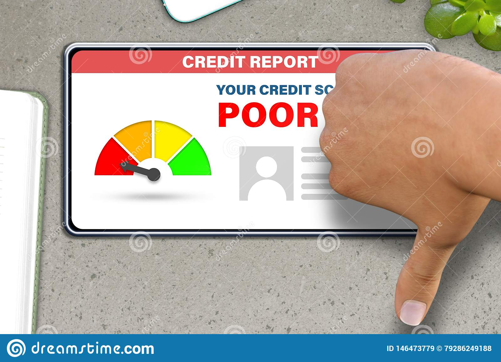 Hand with smart phone shows thumb down or dislike gesture   on stone table background - poor credit score technology concept