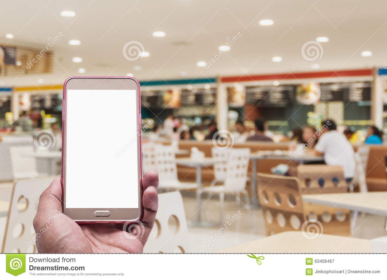 Hand With Smartphone On Blurred In Food Court Background