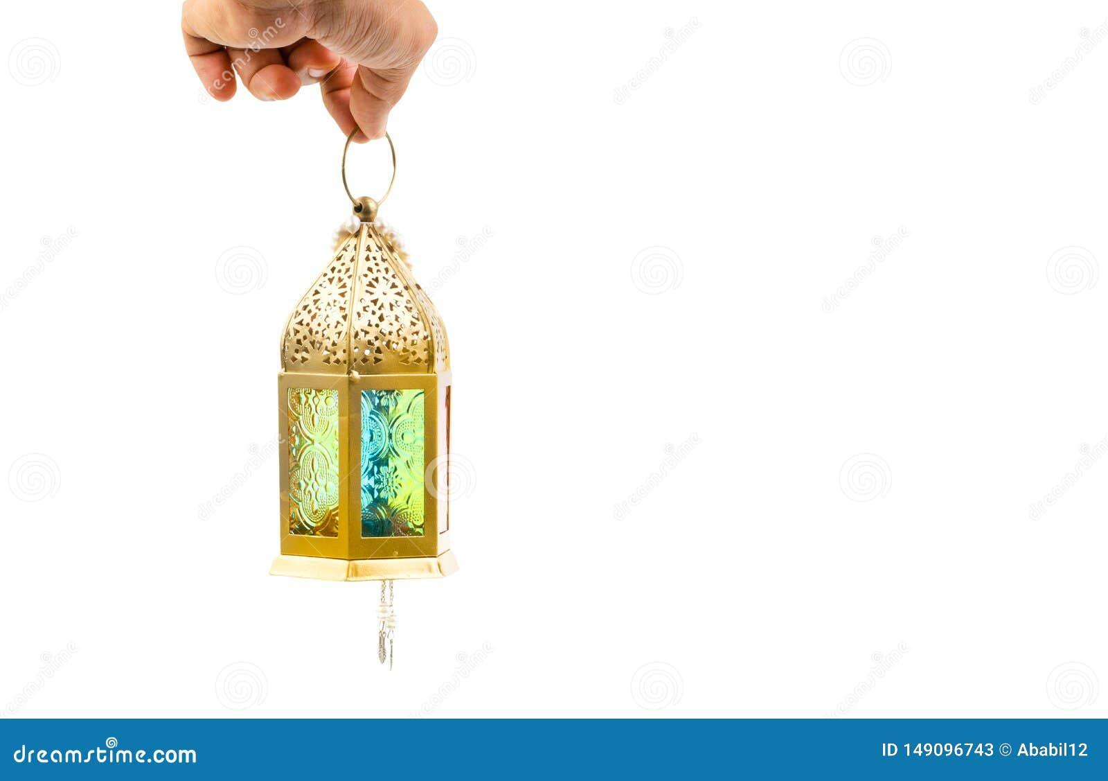 Hand som rymmer den arabiska lyktaisolaten p? vit