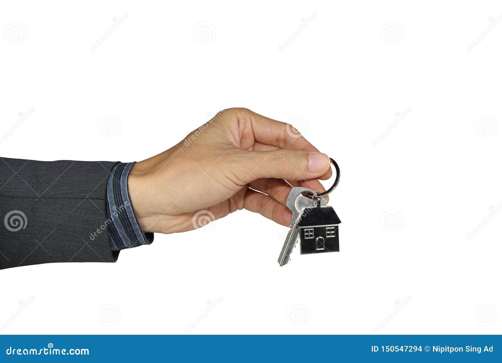 Hand som rymmer hustangenten isolerad på en vit bakgrund, med urklippbanan