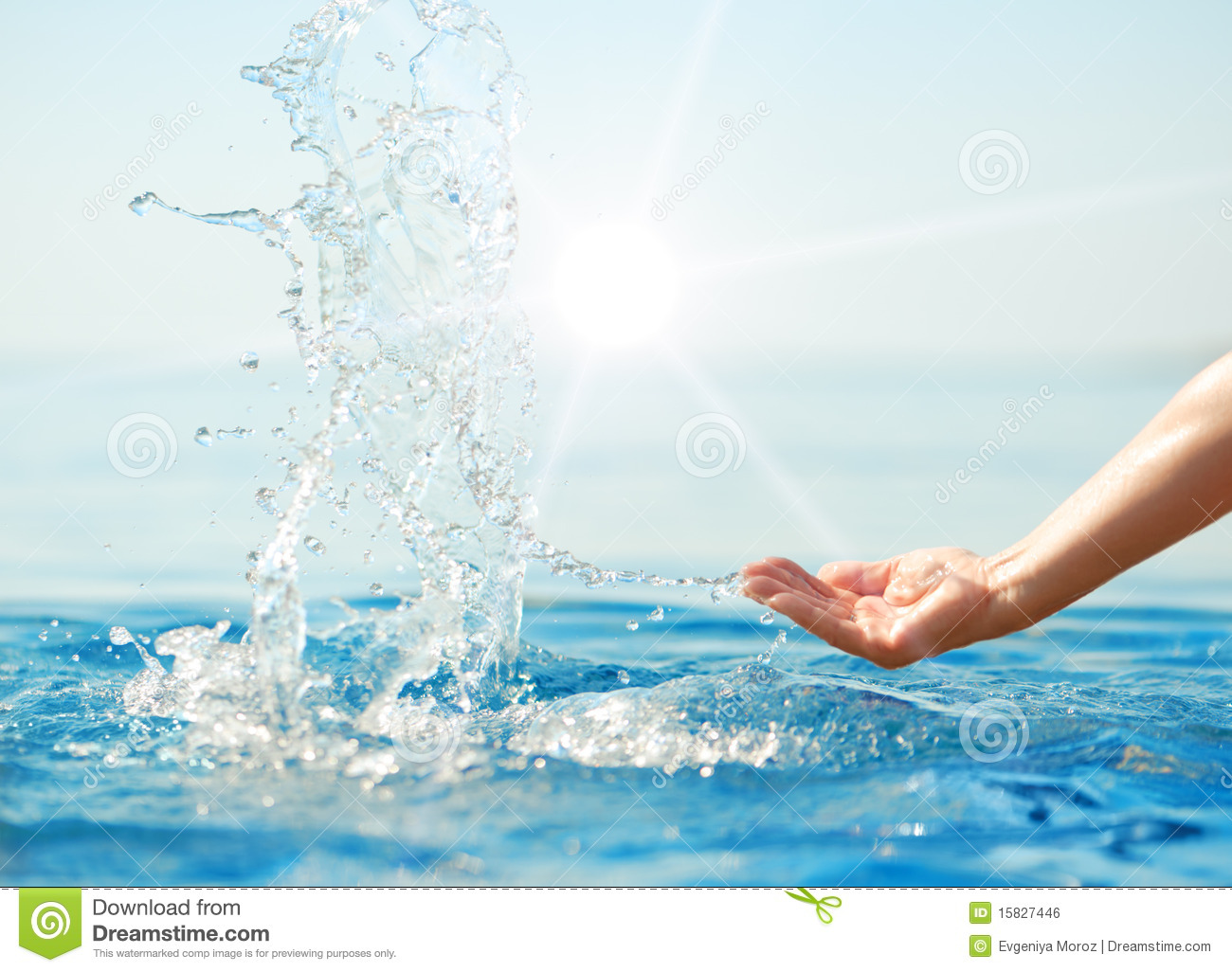 Hand splashing clean water on blue sea background in sun rays. Purity ... Water In Hand