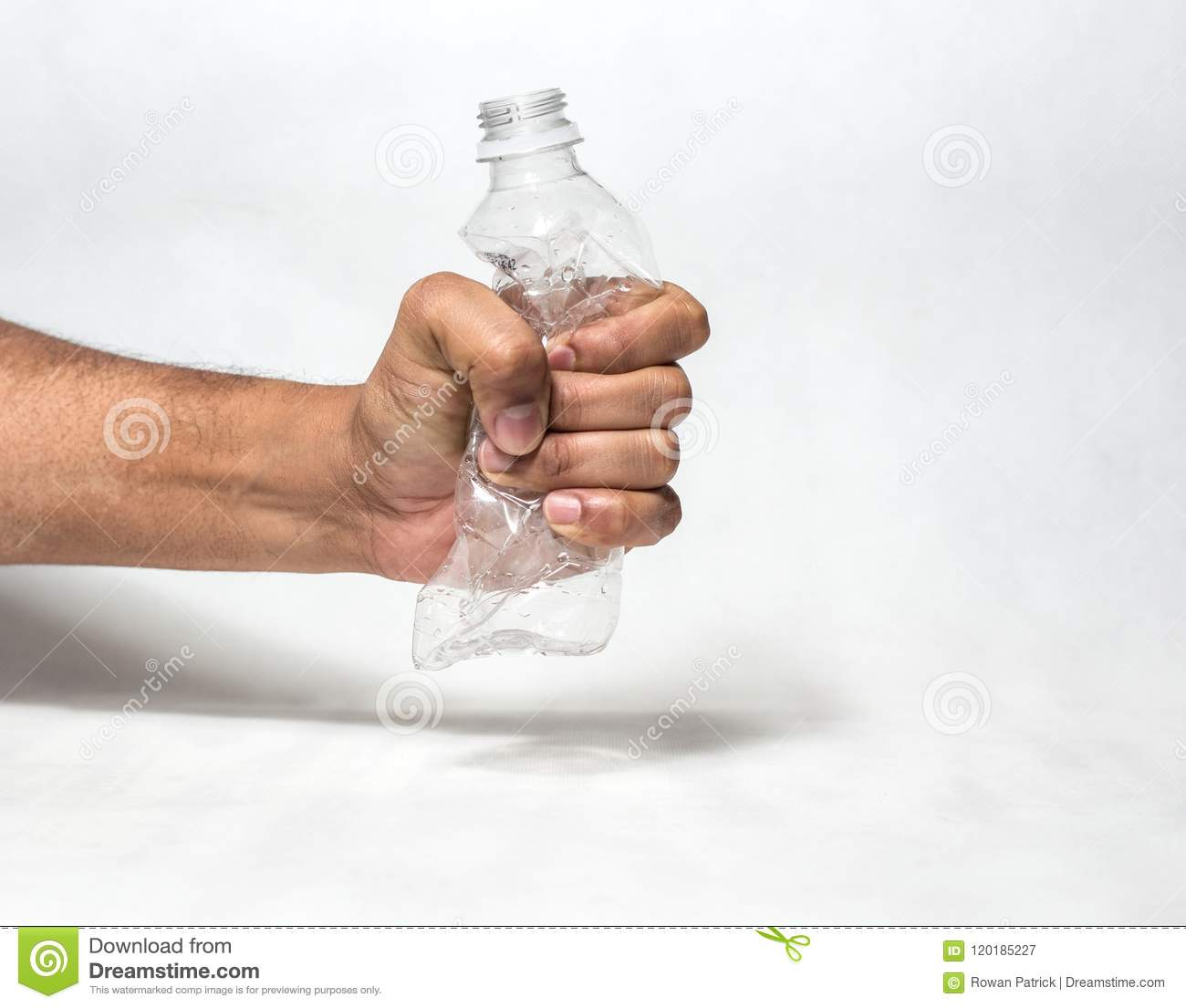 6affa8b88fc Hand squashing empty plastic water bottle resembling ban of single use  plastic recycle