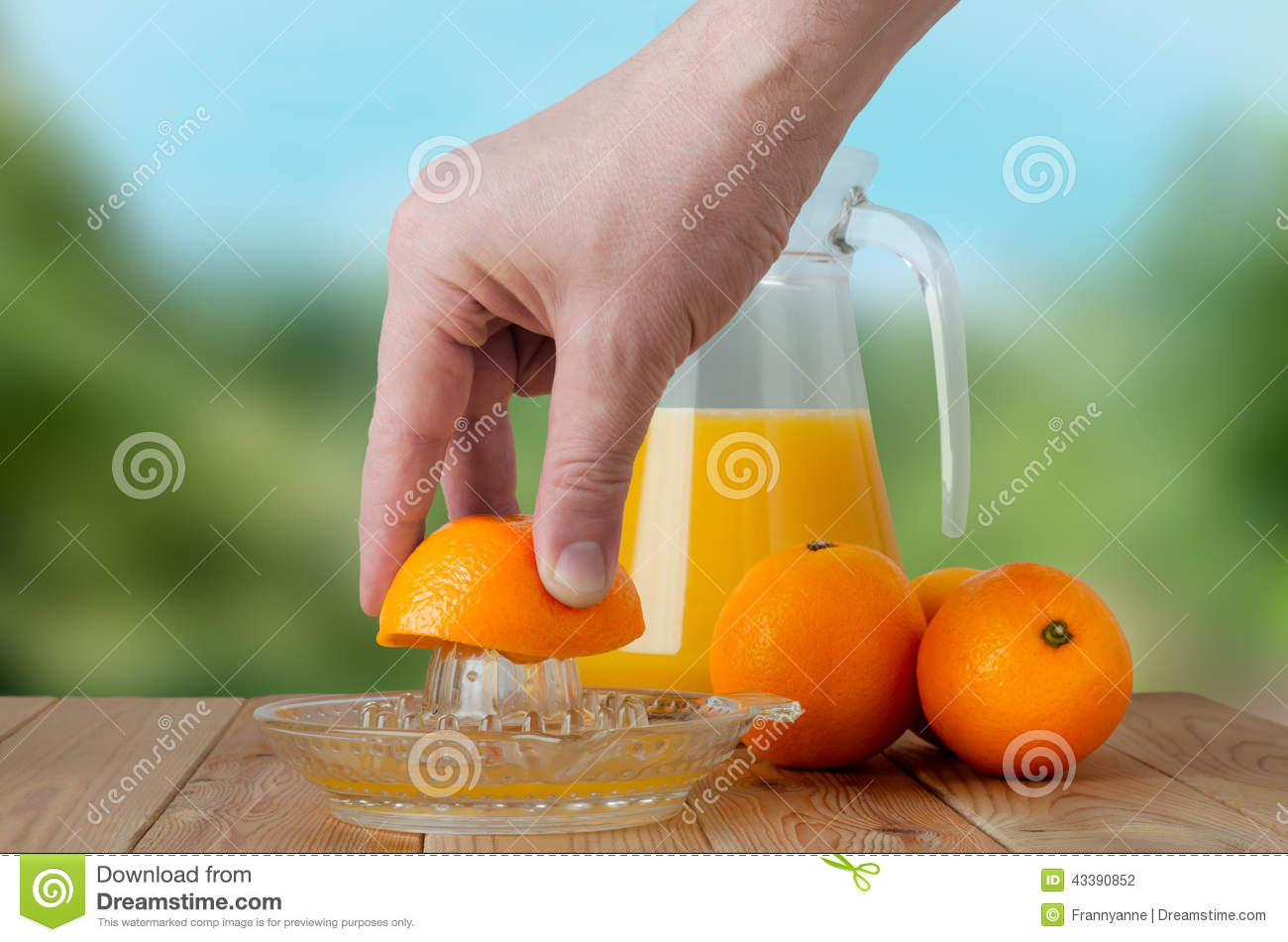 Hand Squeezing Fresh Orange