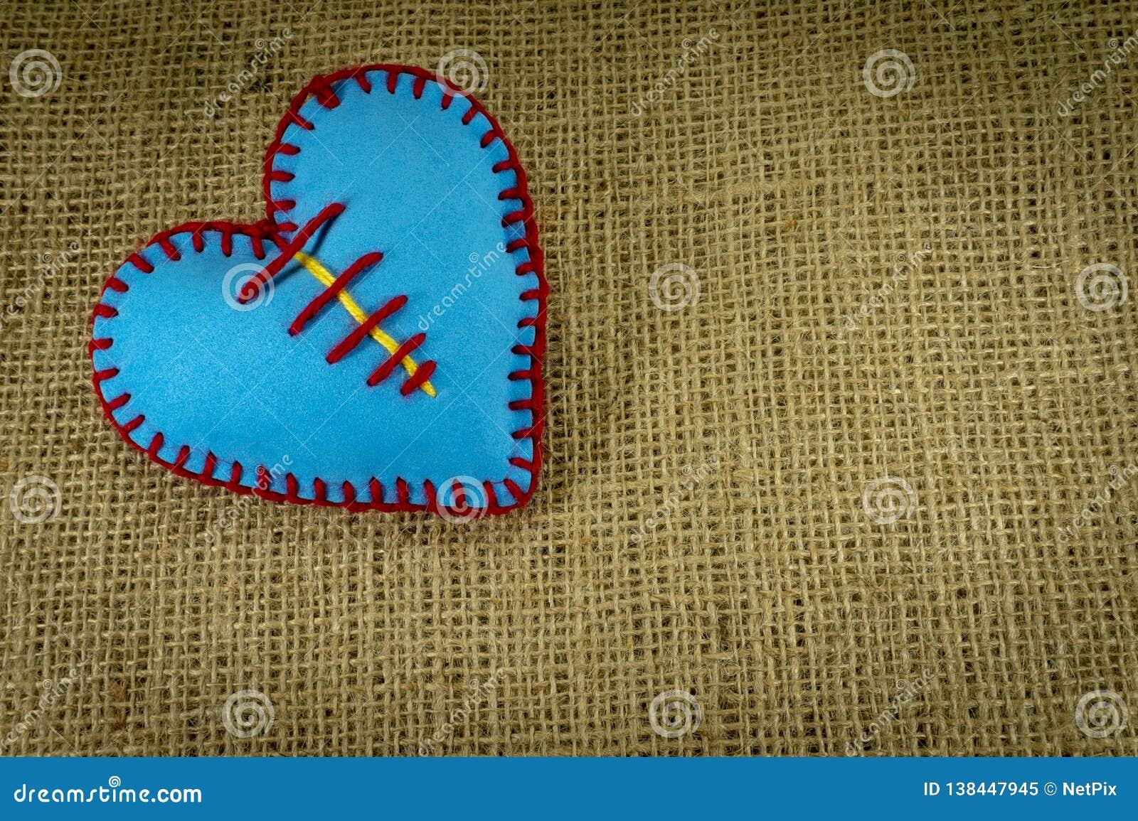 Hand Stitched Blue Foam Sheet Toy Heart On Jute Stock Image - Image