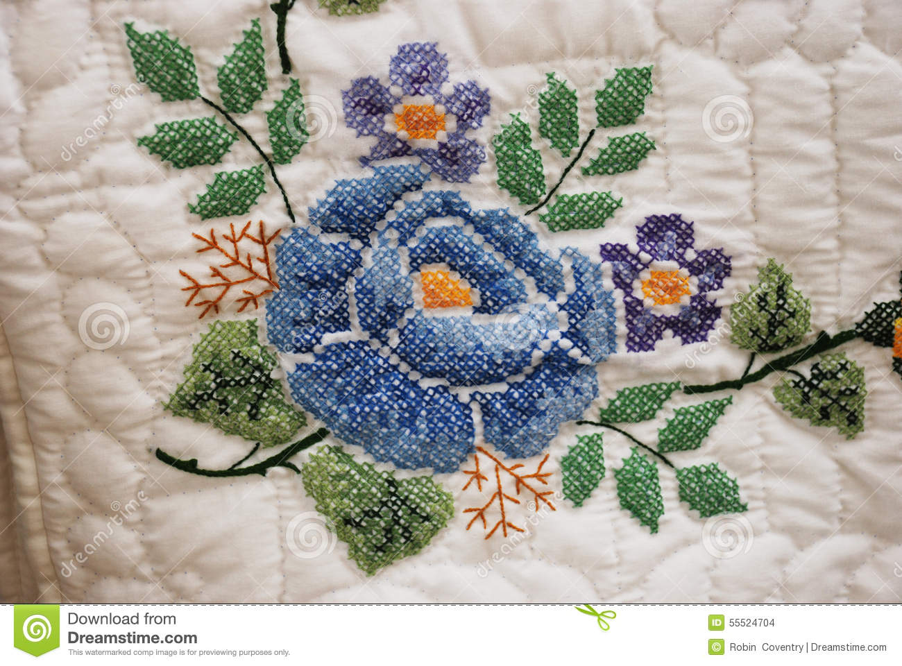 Hand Stitched Embroidered Flower On An Amish Quilt Stock