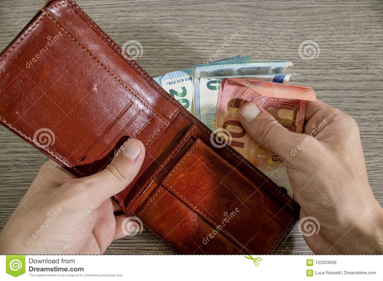 Hand is taking euro banknote from a wallet