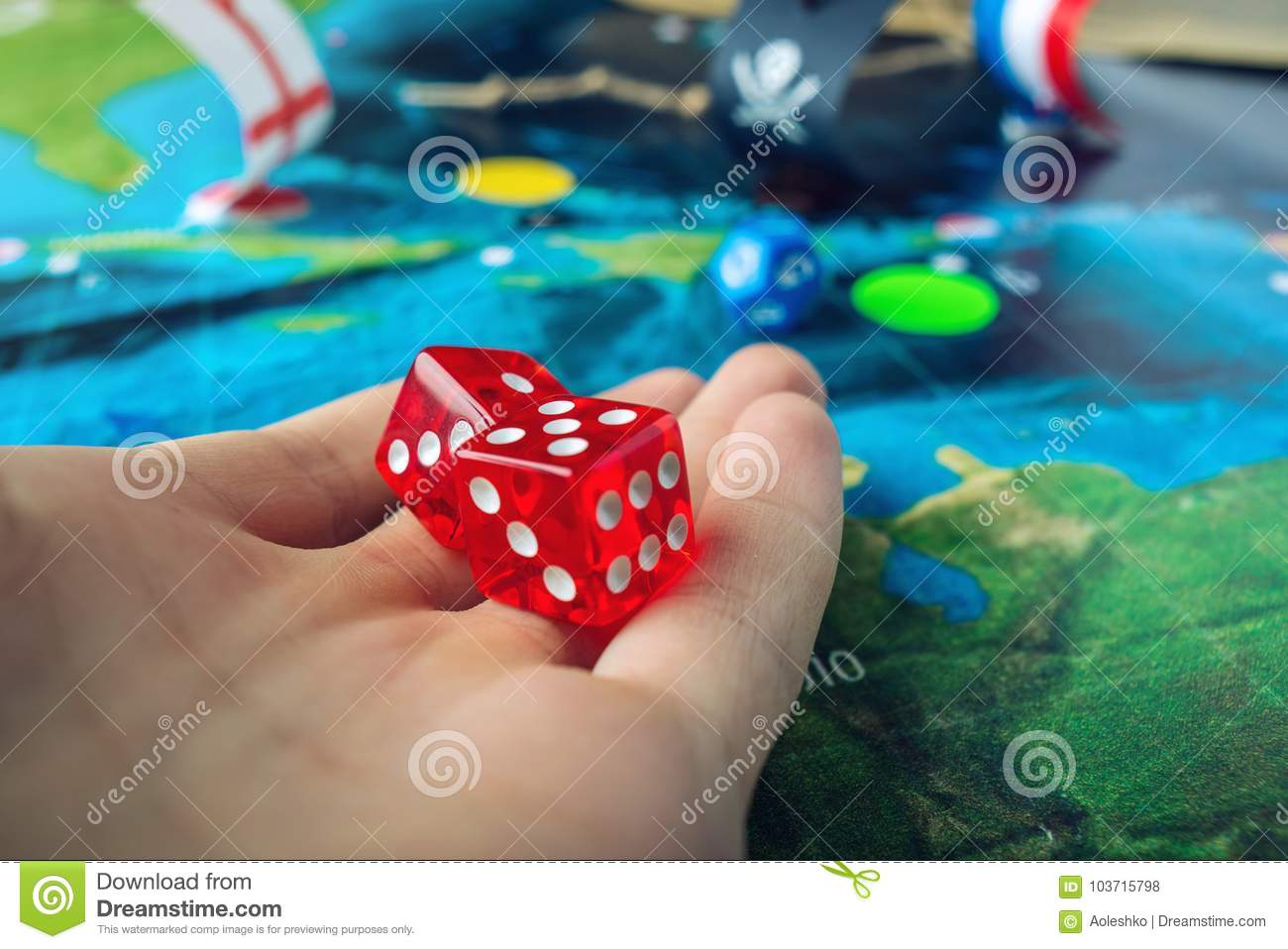 Hand Throwing Red Dice On The World Map Of The Playing Field ...