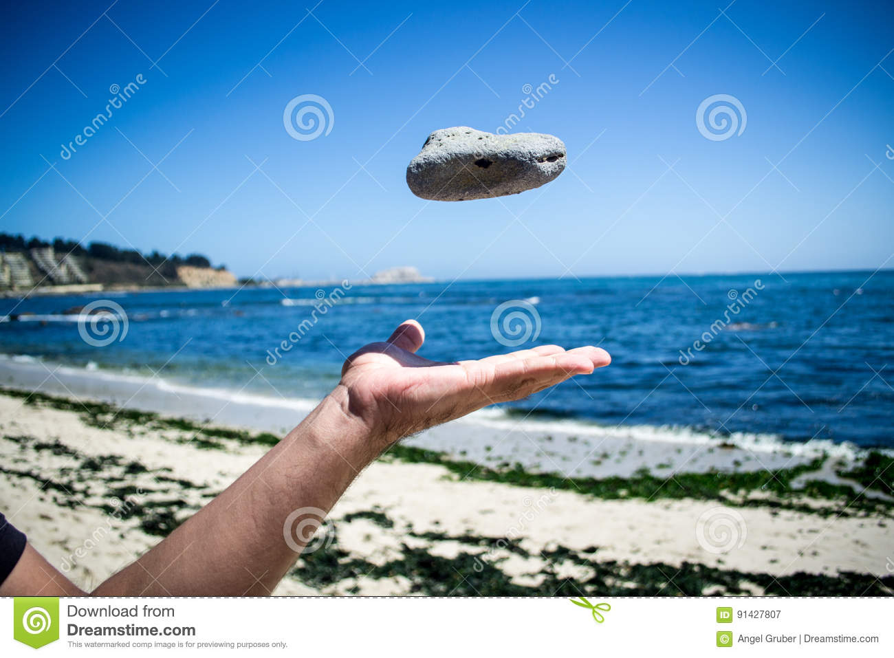 Hand throwing a stone