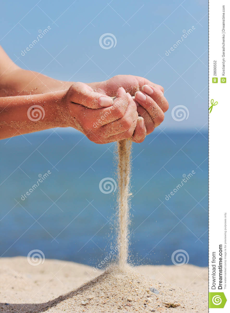 Hand throws sand