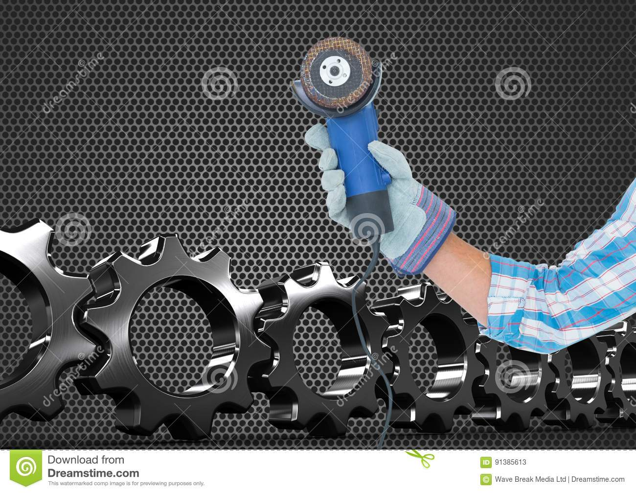 hand with tool with metal and cogs background