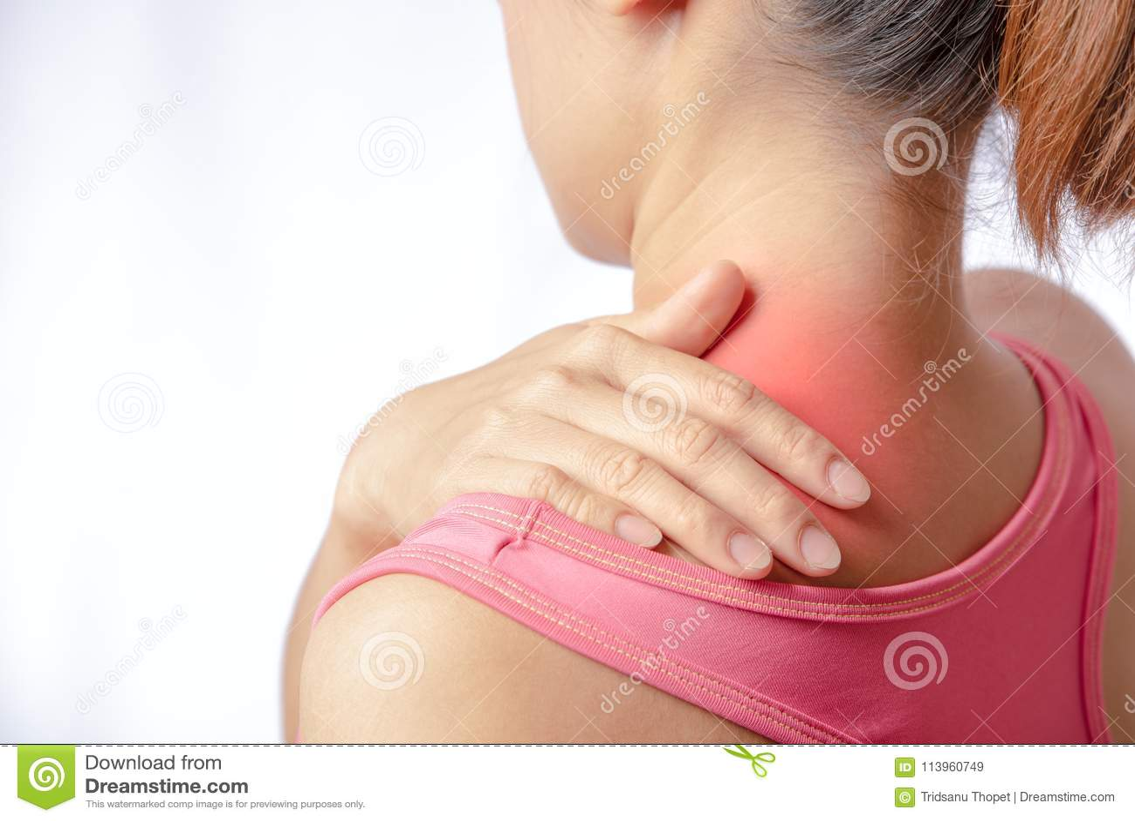 Hand touching trapezius muscle area