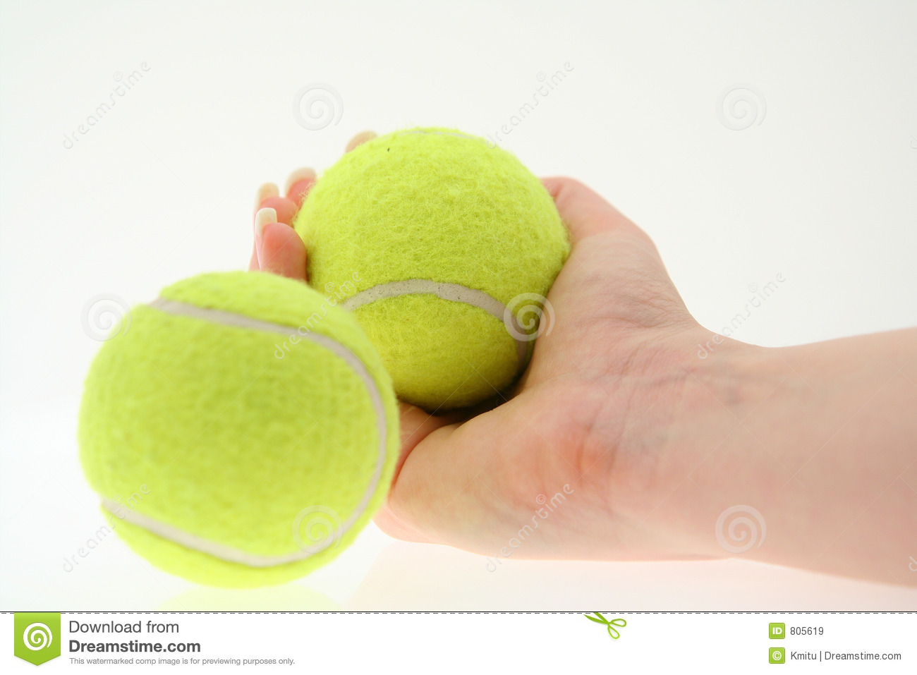 Hand with two tennis balls, shallow DOF, ball in the foreground is out ...
