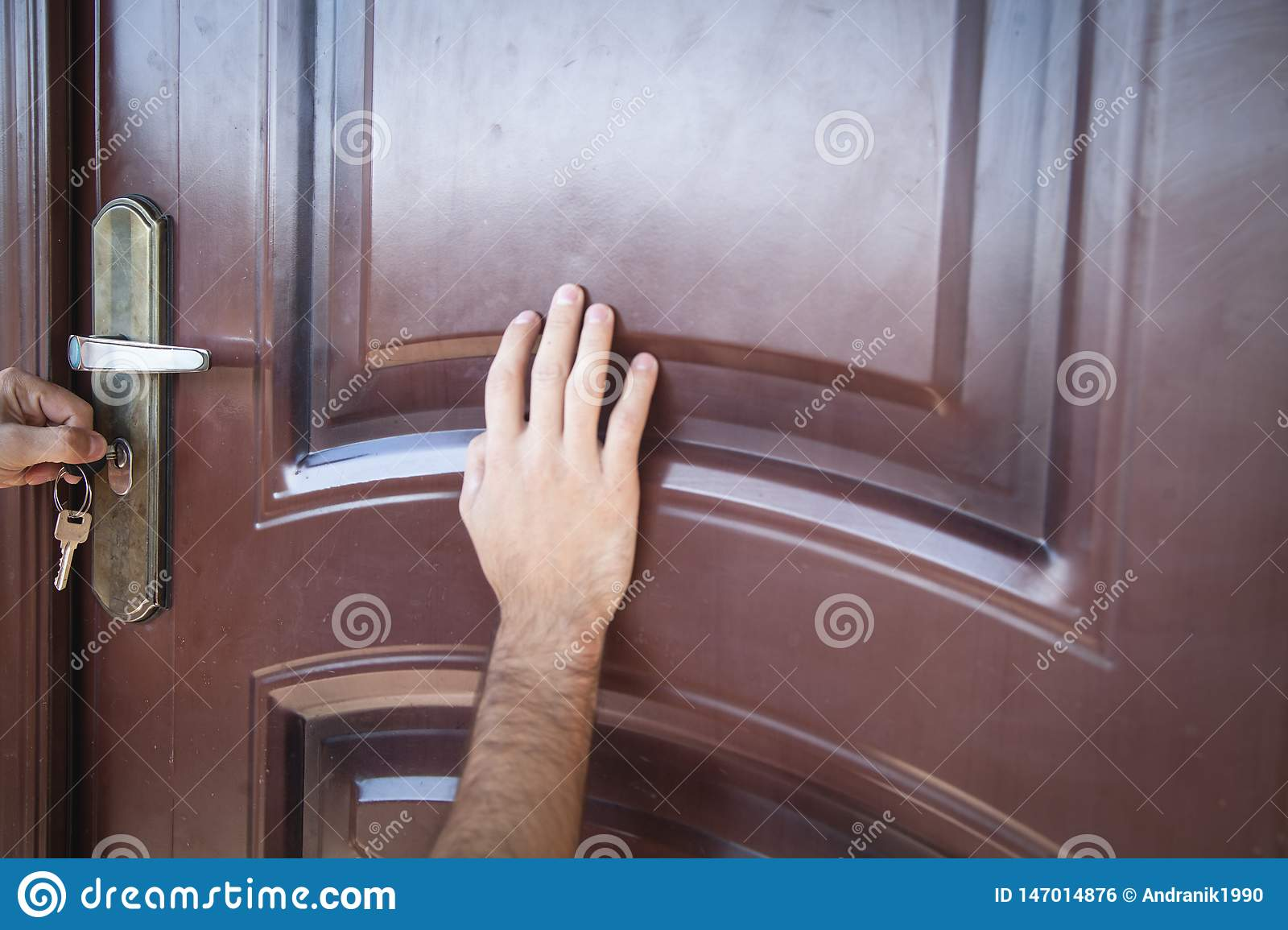 Hand Unlocking The Door With Key Stock Photo - Image of real