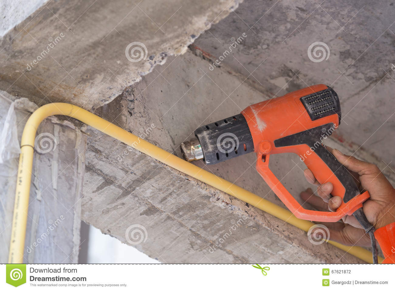 Hand use a heat gun to bending electric PVC pipe. Hand of worker use a & Electrical Pipe Bending Stock Photos - Royalty Free Images