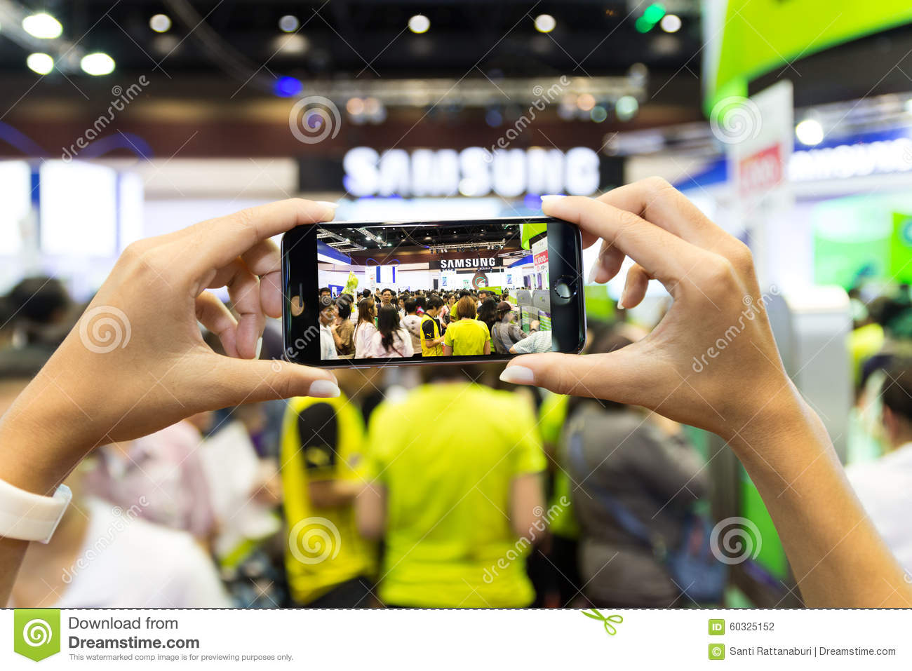 hand use smartphone capture crowd in thailand mobile expo. Black Bedroom Furniture Sets. Home Design Ideas