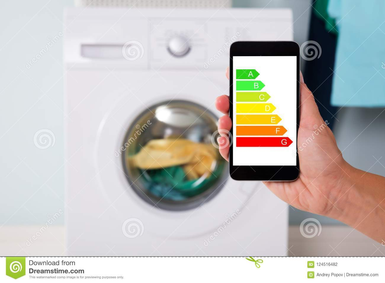 Hand Using Energy Label On Mobile Phone Against Washing