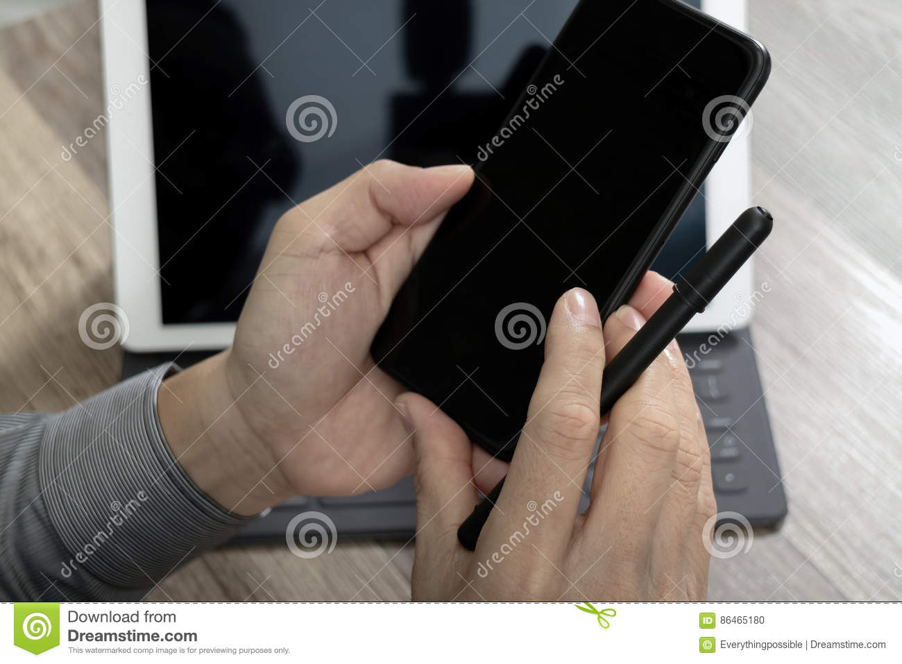 Hand using mobile payments online shopping,omni channel,icon customer network,in modern office wooden desk, blank interface screen