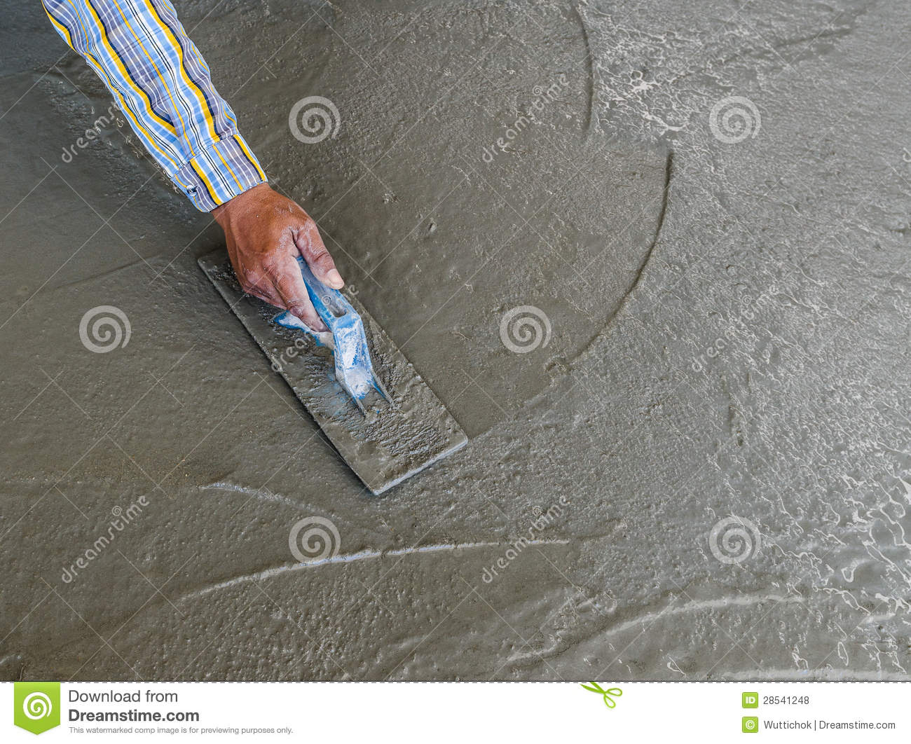 Hand Using Trowel To Finish Wet Concrete Floor Royalty