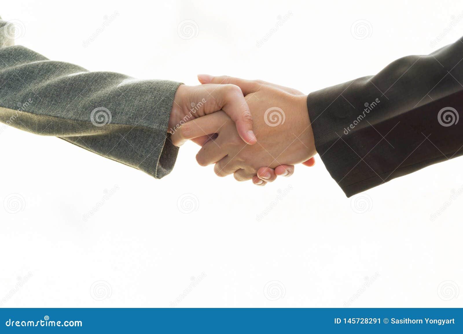 Hand van het bedrijfspaar schudden handen