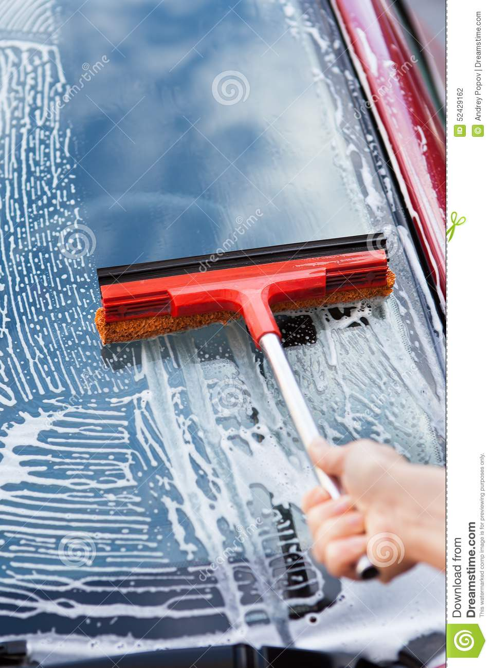 hand washing car window with mop stock photo image 52429162. Black Bedroom Furniture Sets. Home Design Ideas
