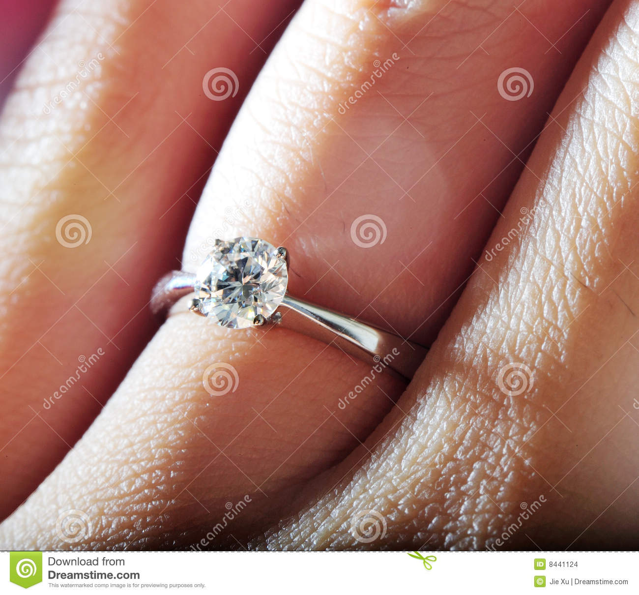 Hand wearing diamond ring