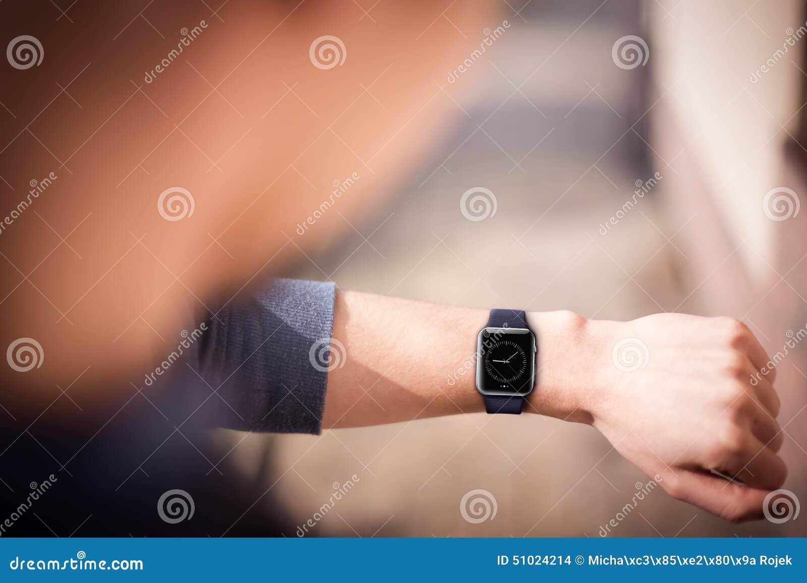 Hand wearing elegant smartwatch