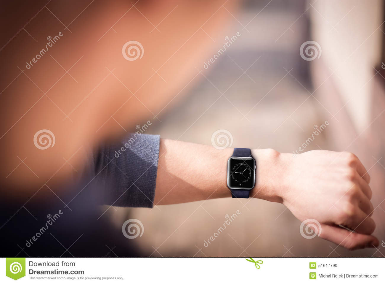 Hand wearing smartwatch