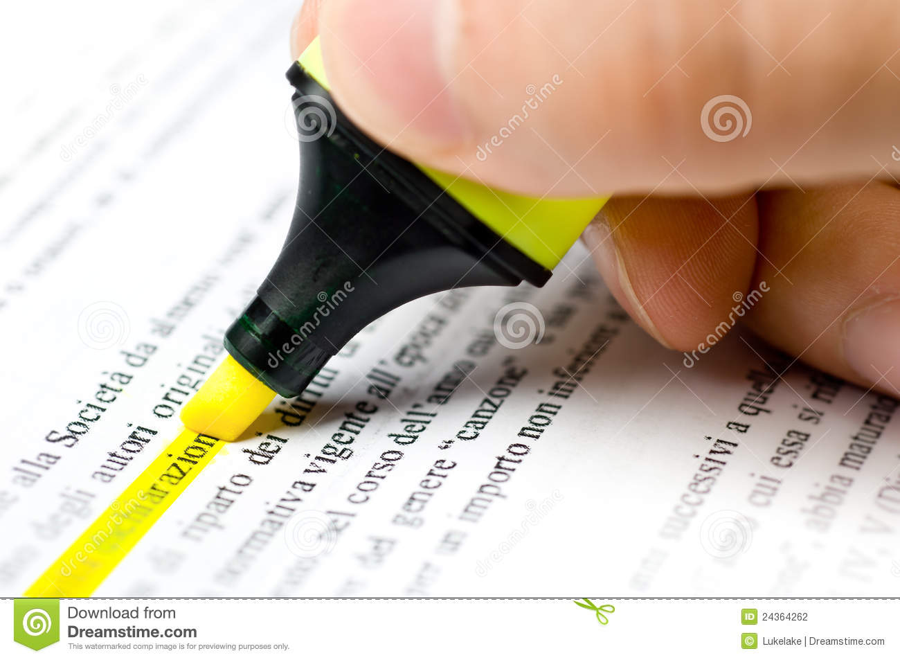 An Hand Who Writes With An Highlighter On A Paper Stock