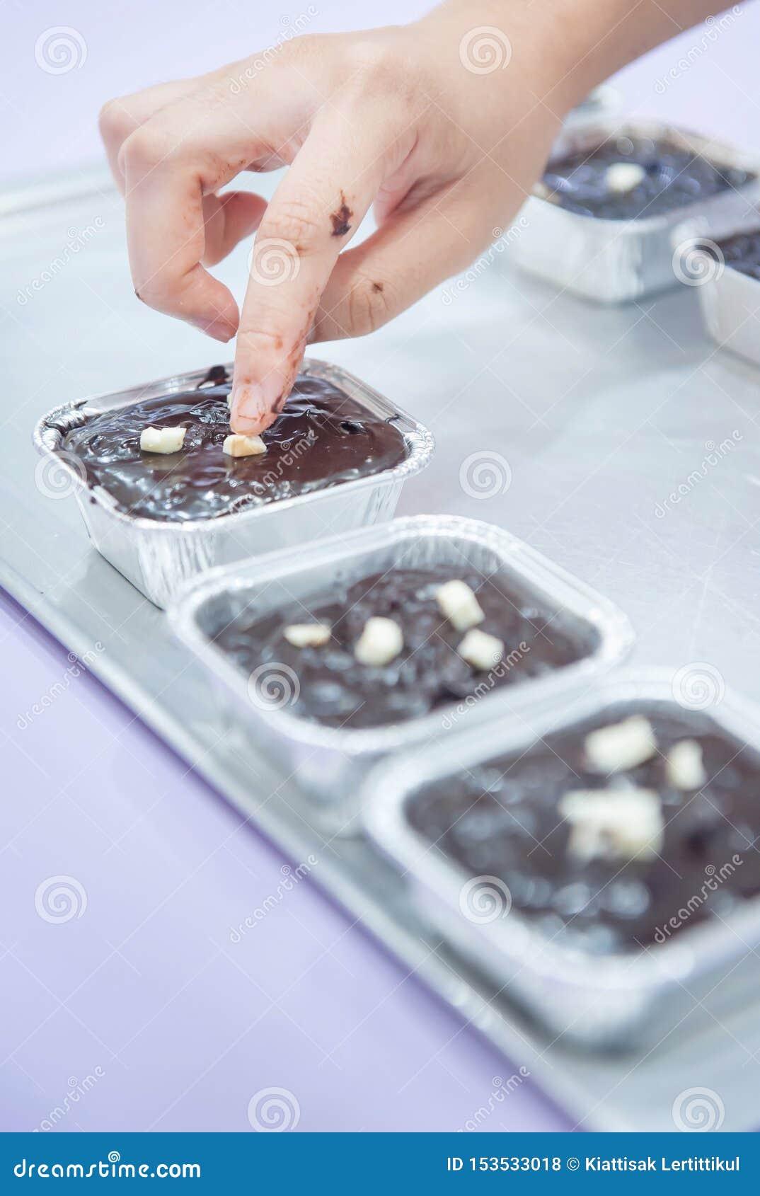 chocolate brownie hand woman marshmallow