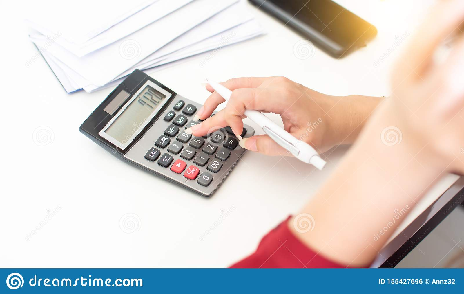 Hand of woman is using calculator
