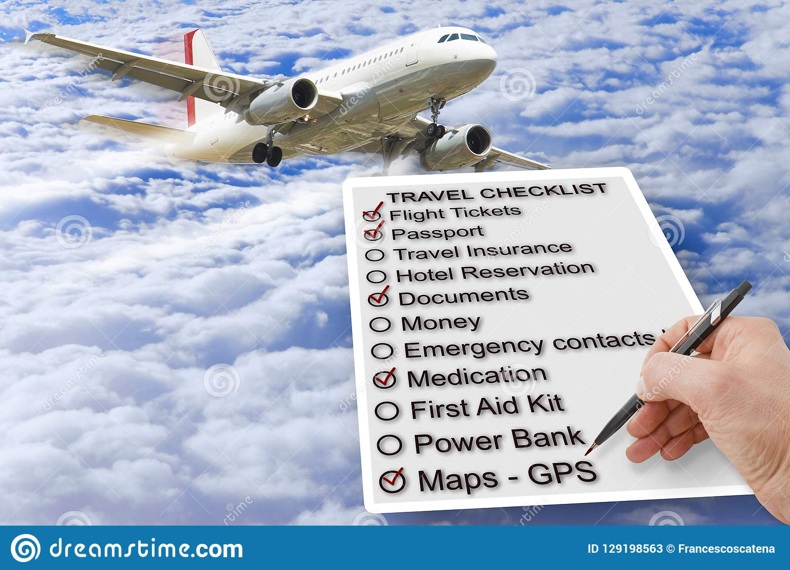 hand write a travel checklist over a cloudy sky and airplane c