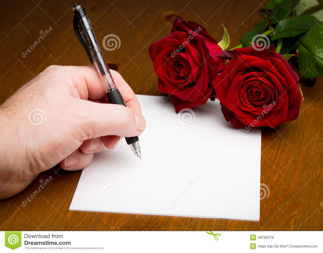 hand writing a love valentine letter with roses stock photo 48762076 megapixl