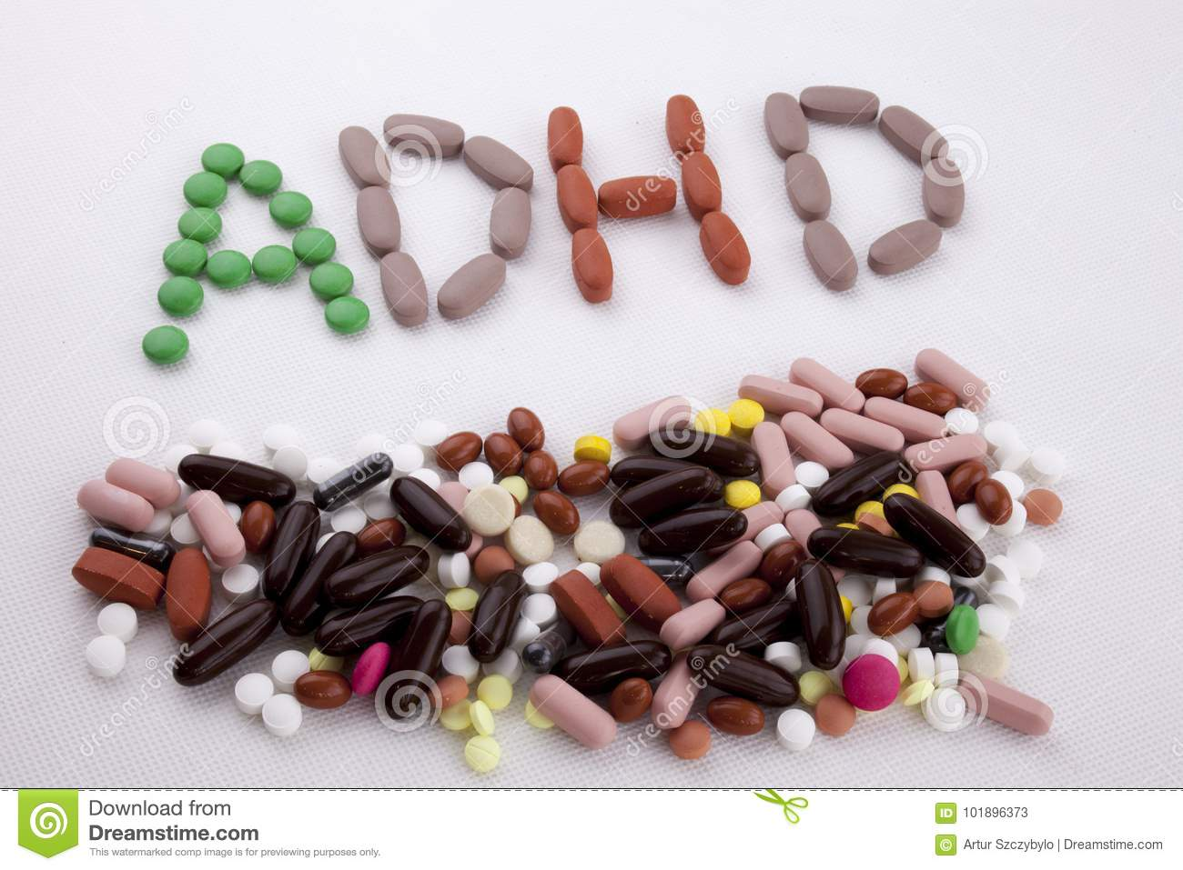 Hand writing text caption inspiration Medical care concept written with pills drugs capsule word ADHD Attention Deficit Hyperactiv