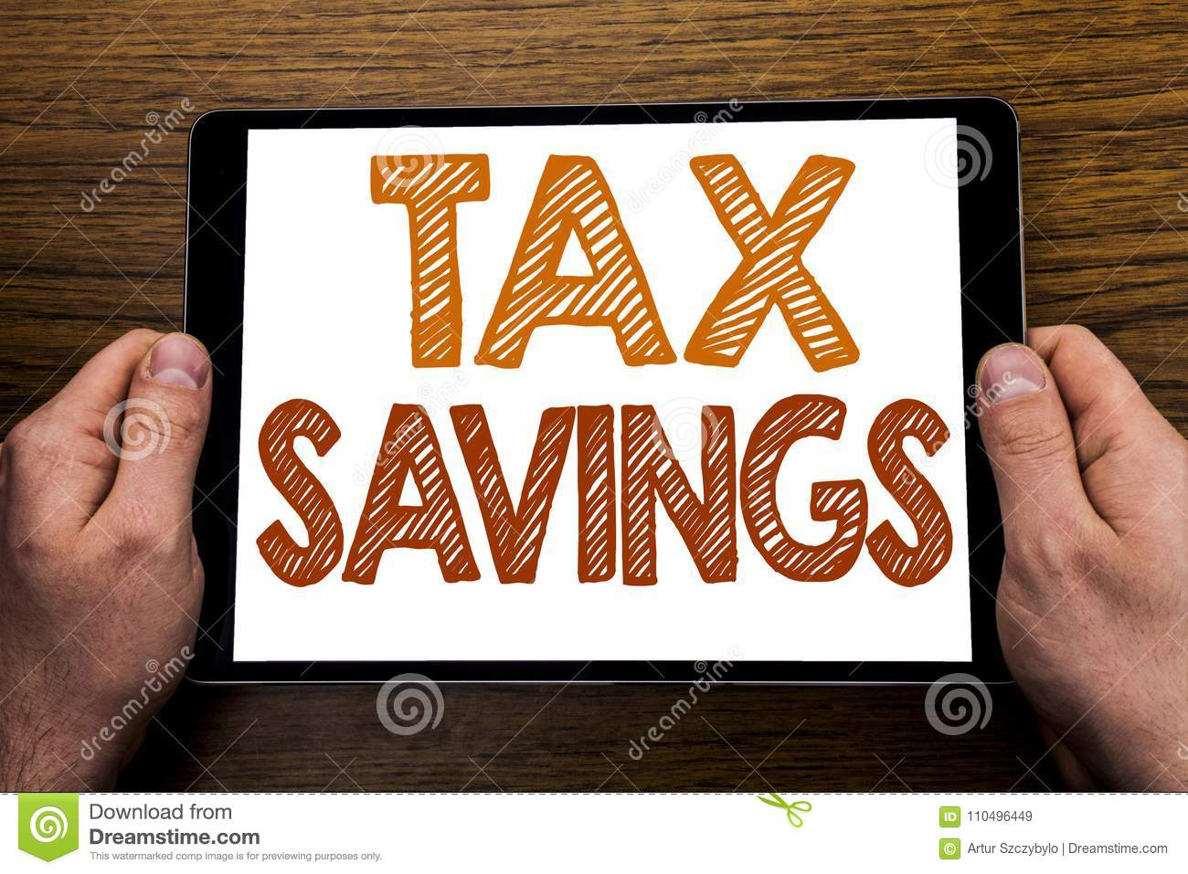 Hand writing text caption Tex Savings . Business concept for Tax Savings Extra Money Refund Written on tablet laptop, wooden backg