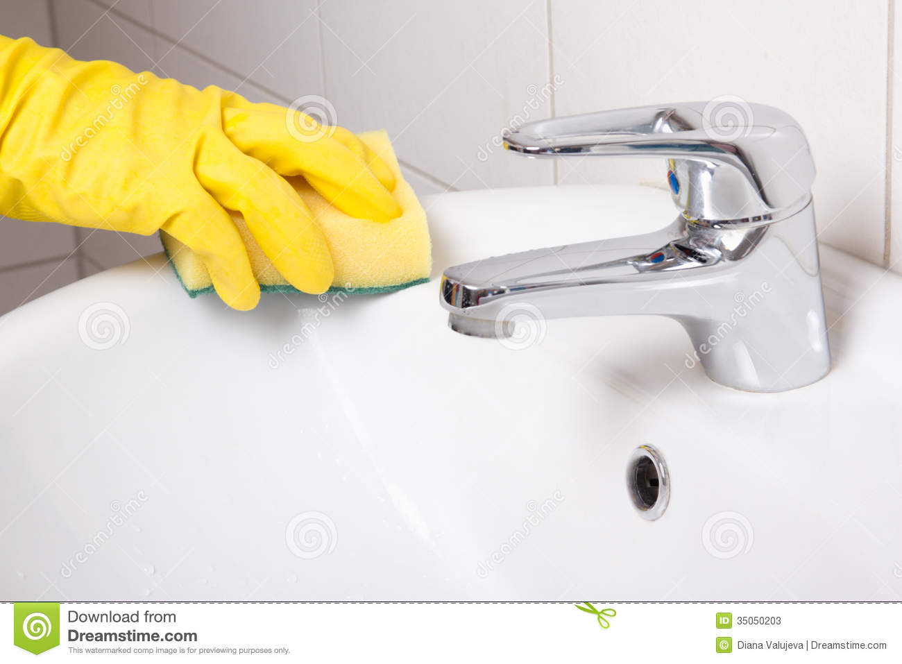 remove bathroom sink in yellow glove with sponge cleaning sink stock 14159