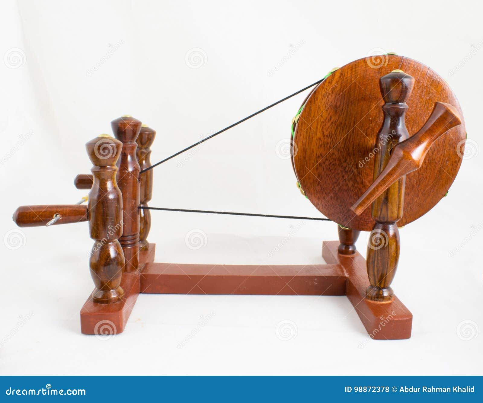 Handcraft Wooden Spinning Wheel - Indian Charkha Stock Photo