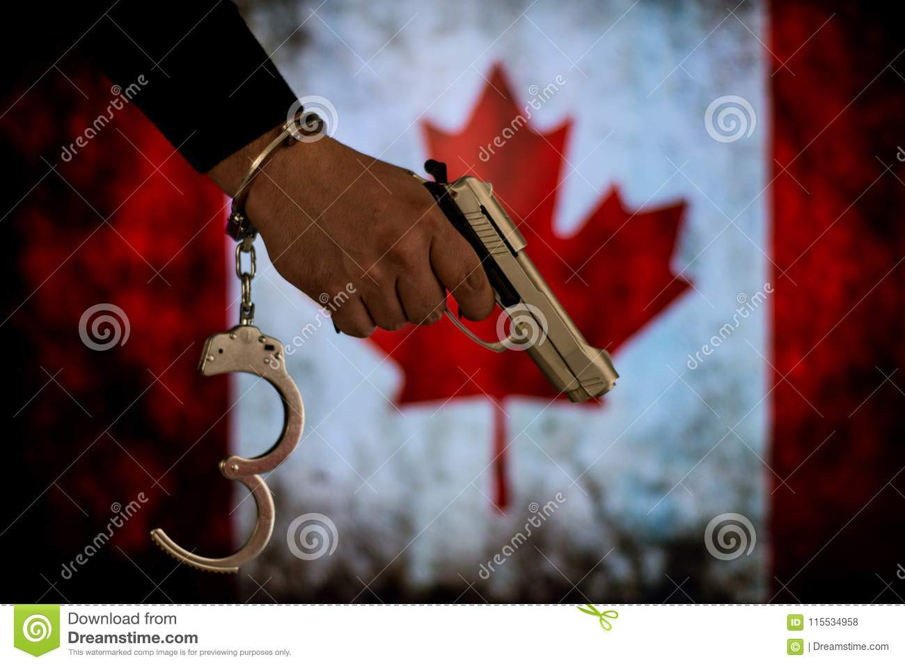 Handcuffed hand in front of the country flag. crime concept