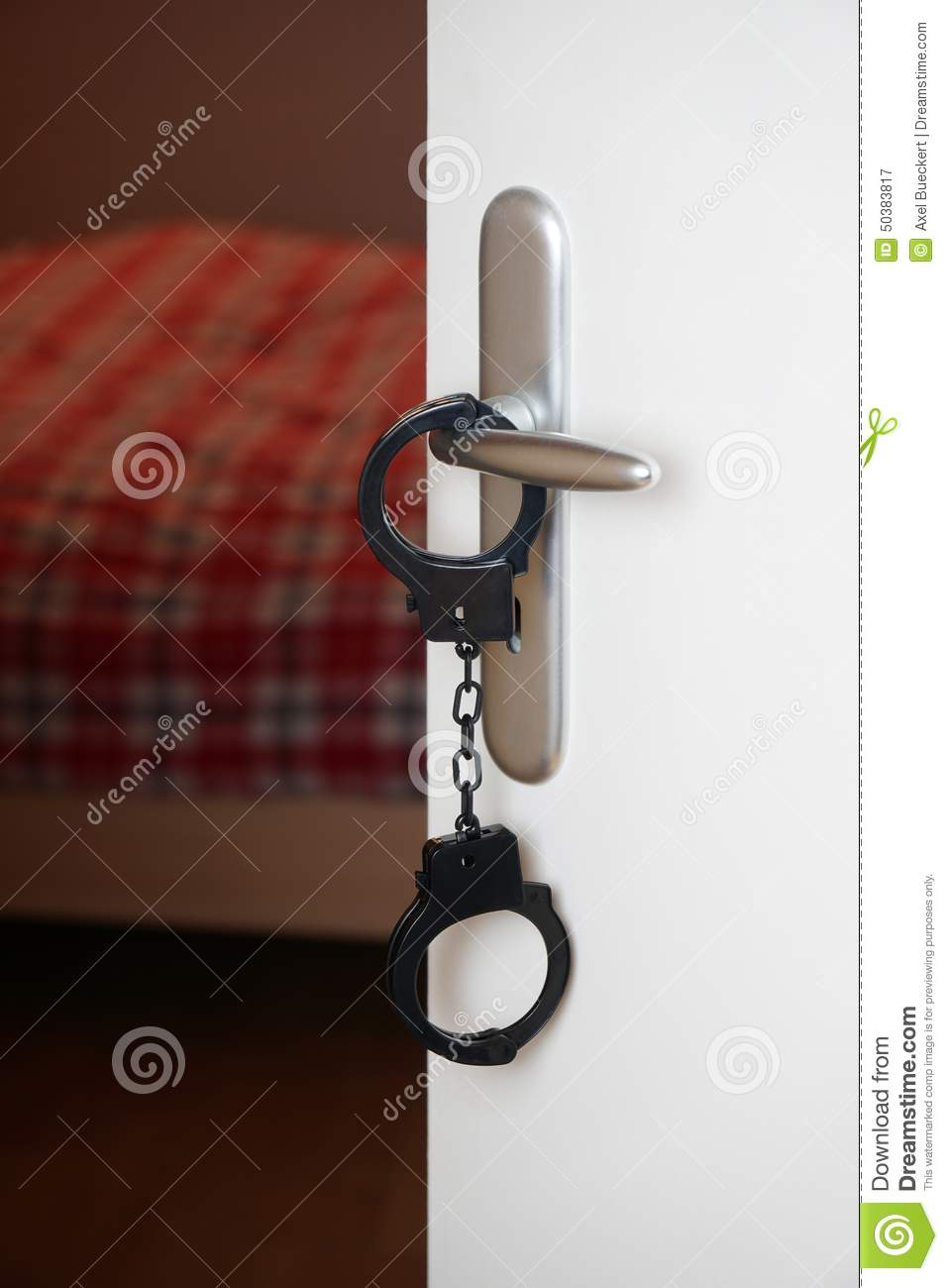 handcuffs on bedroom door handle stock photo image 50383817
